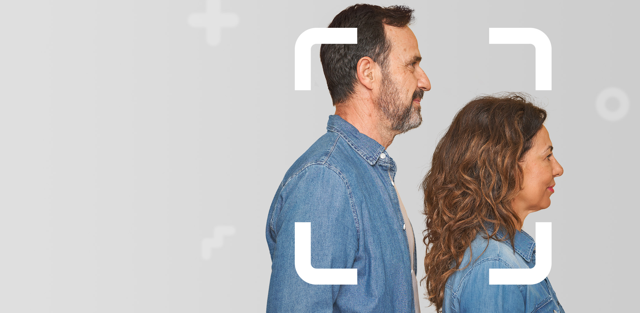 Middle aged couple facing sideways both dressed in denim focusing on their personal savings future