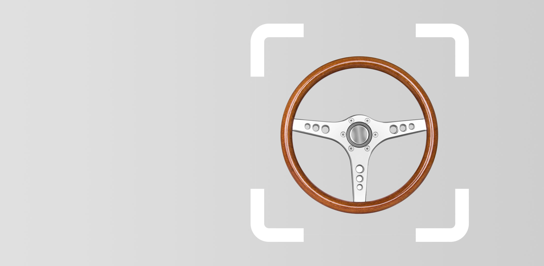 Old wooden sports car steering wheel